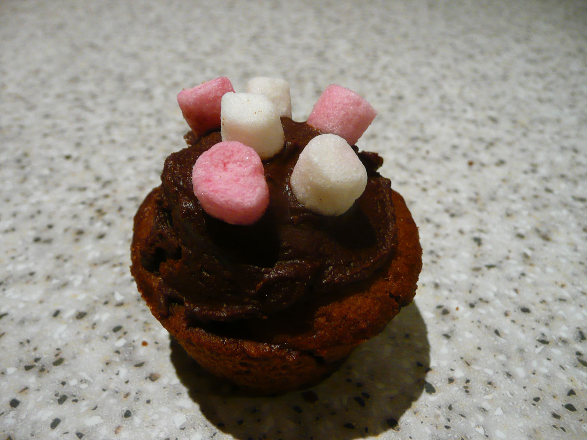 Chocolate mini muffin topped with pink and white mini marshmallows