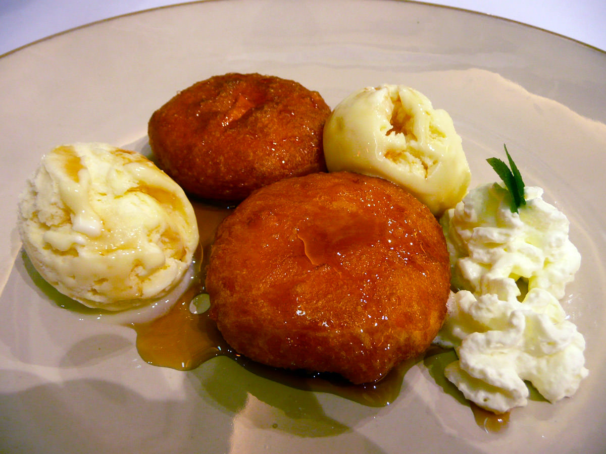 Sweet potato cakes with ice cream and cream