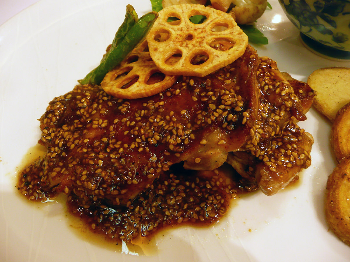 Grilled chicken thighs with sesame and miso sauce topped with fried lotus root