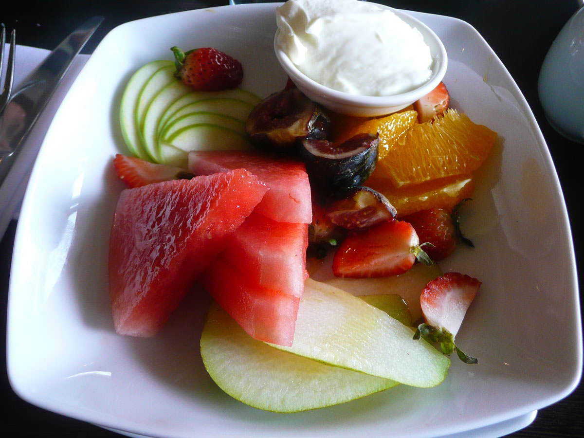 Fresh fruit plate, yoghurt and thyme honey