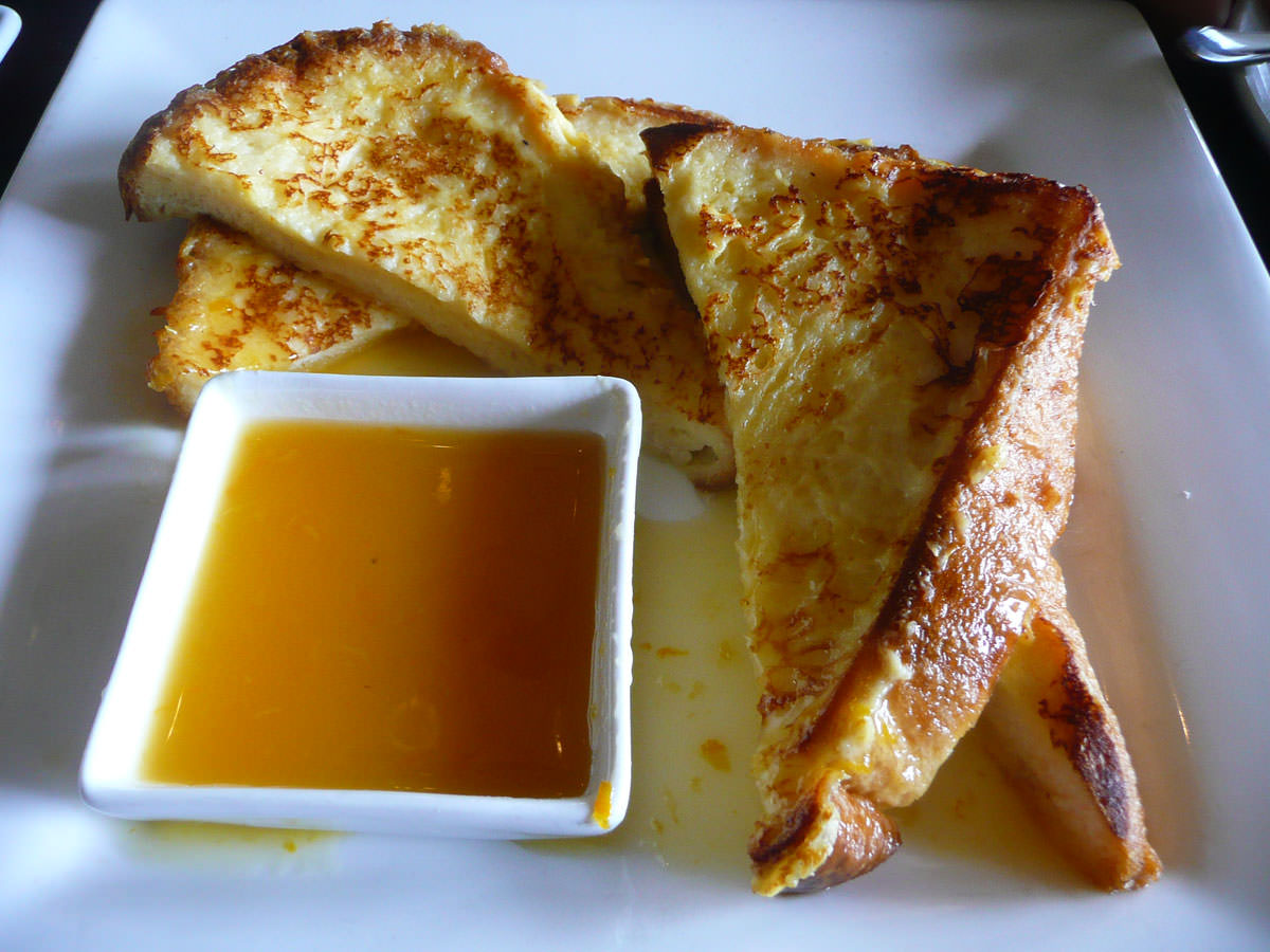 Glazed orange and lemon torrijas (French toast)
