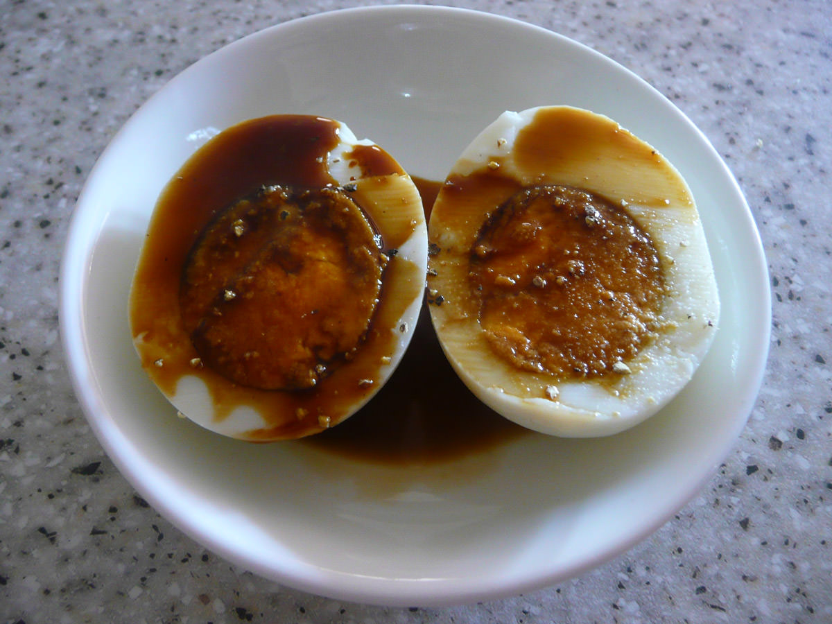 Hard-boiled egg with soy sauce and black pepper