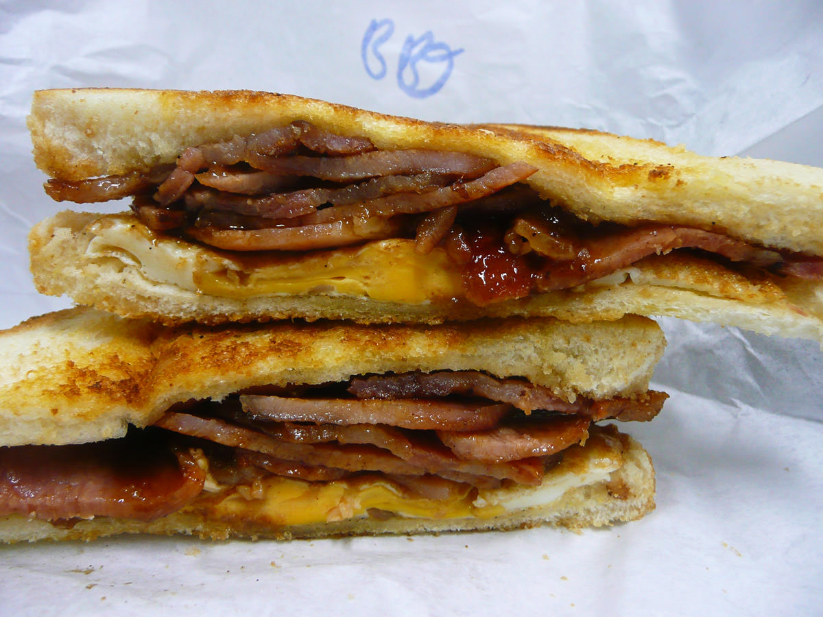 Bacon and egg toasted sandwich with BBQ sauce
