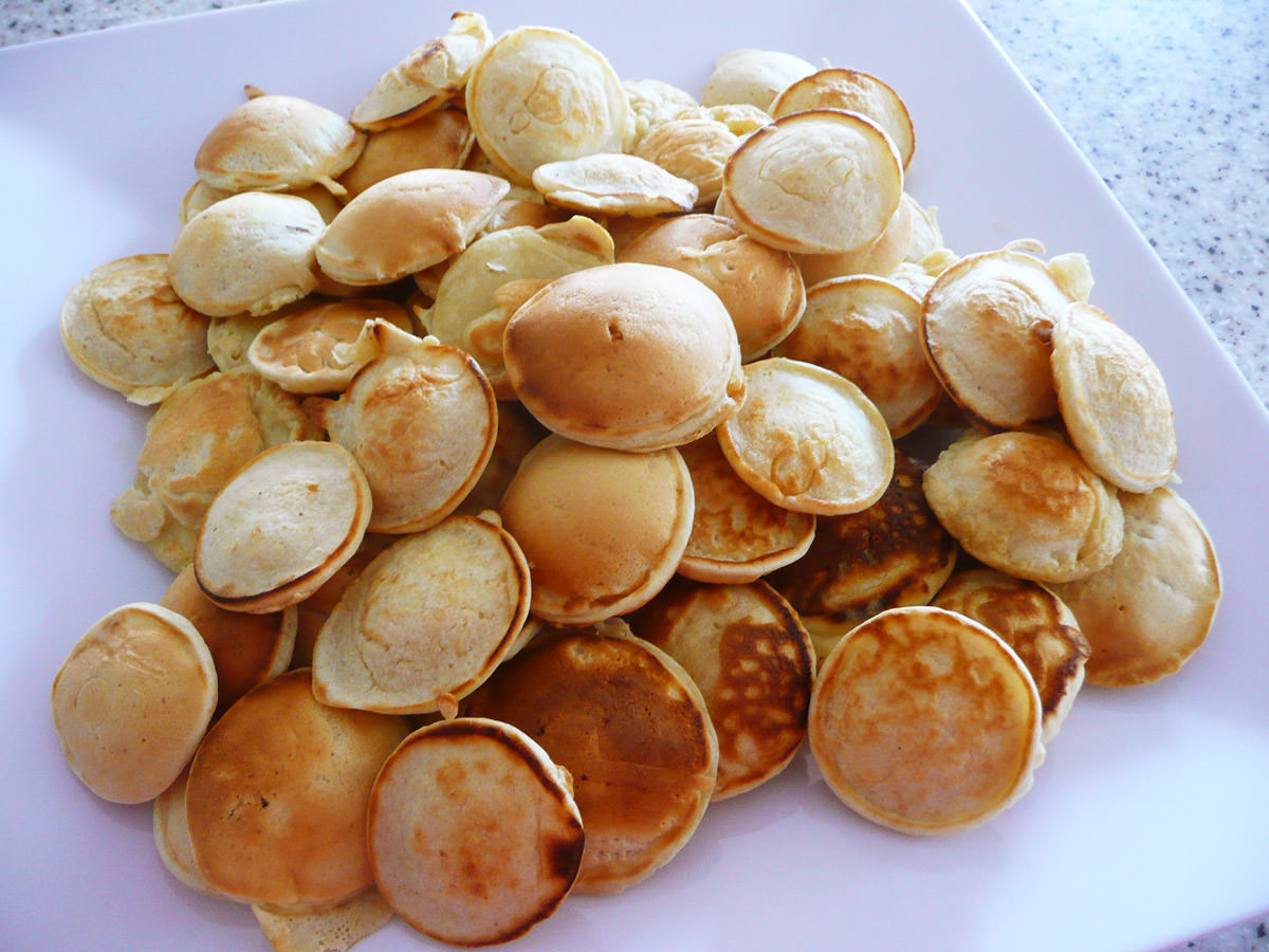 Platter of poffertjes (Dutch mini pancakes)