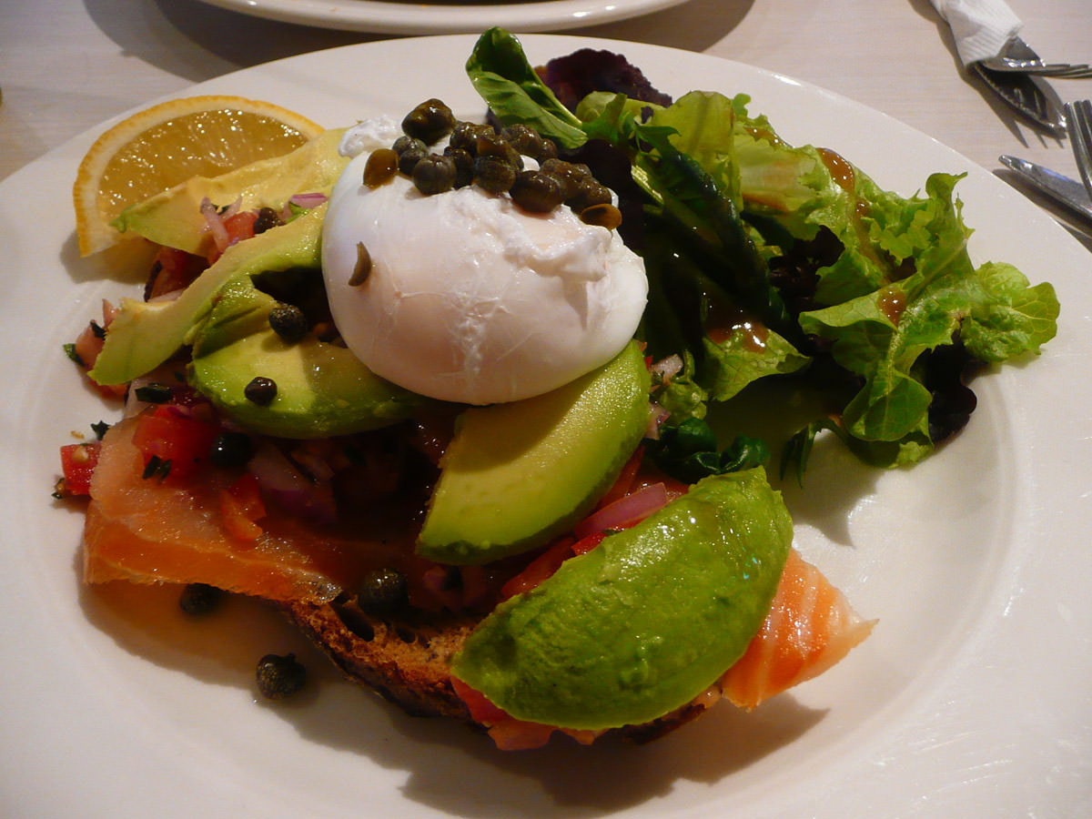 Open rye sandwich with smoked salmon and poached egg