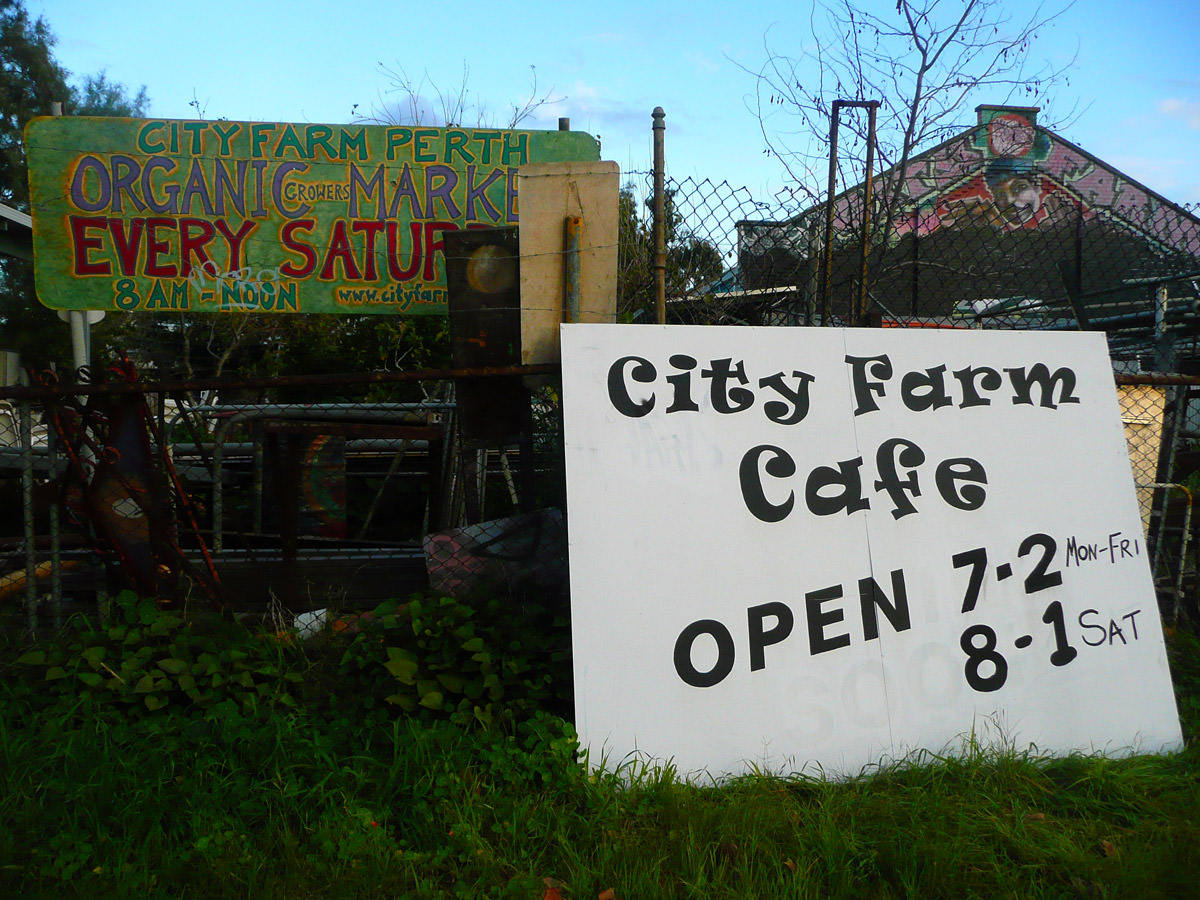 City Farm Cafe sign - opening hours 7am -2pm Mon - Fri, 8am - 1pm Sat