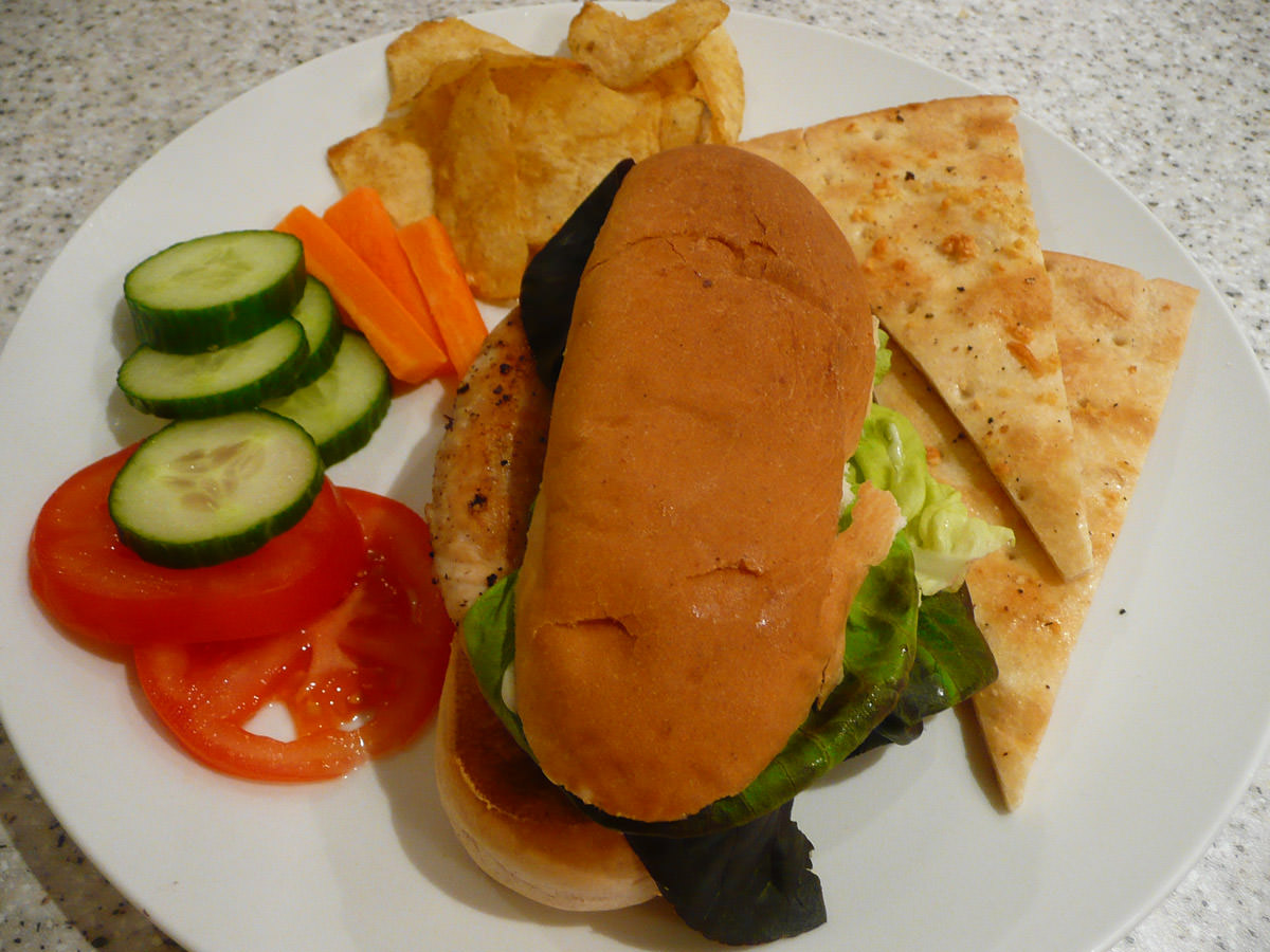 Turkey breast sandwich, salad, crisps and garlic pizza