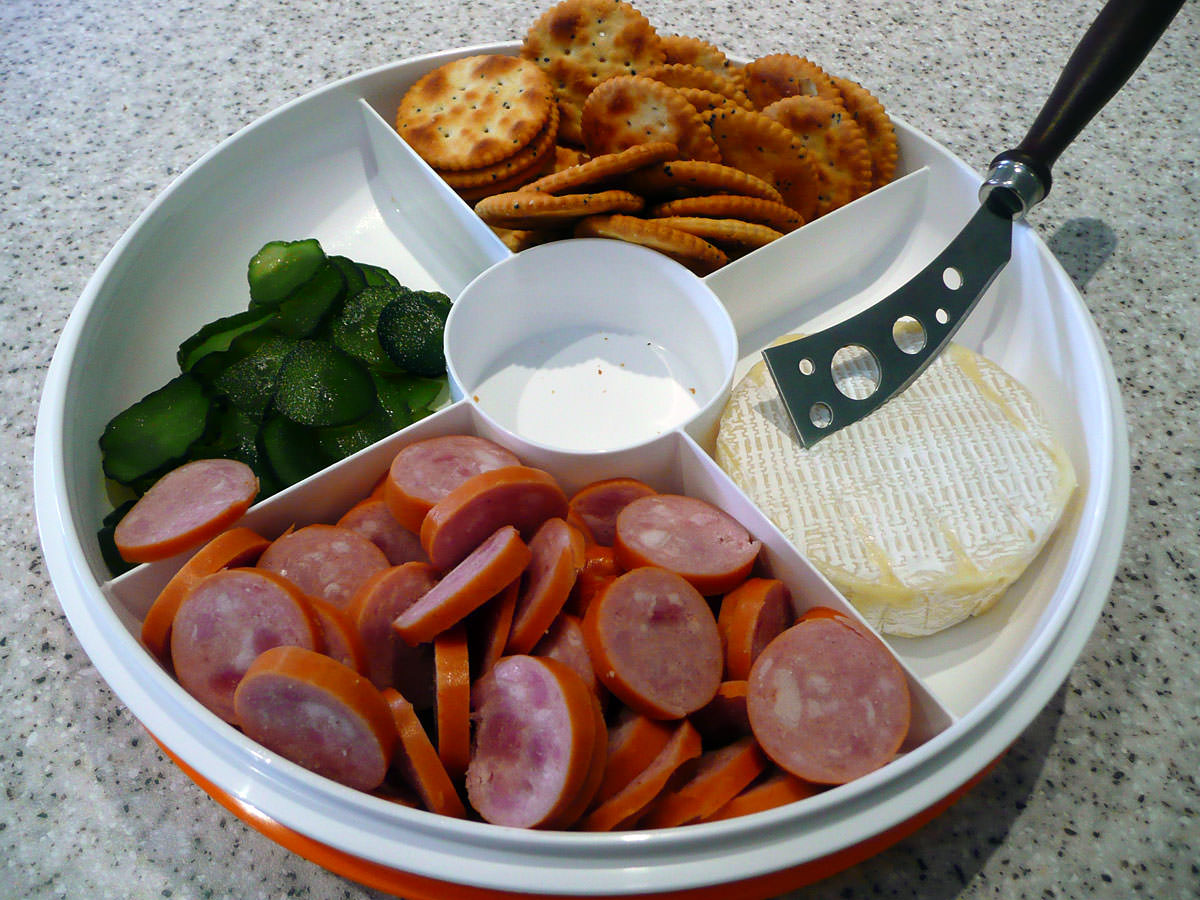 Sausage, sweet pickles, crackers and cheese