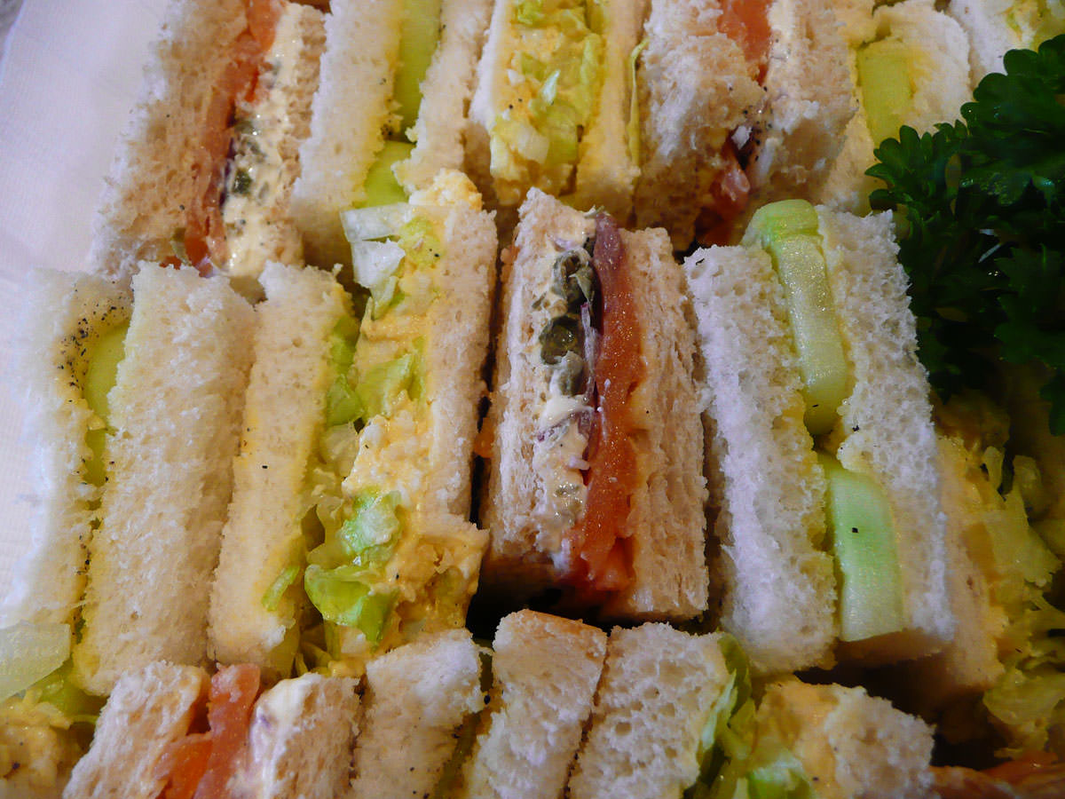 Sandwiches close-up - hard-boiled egg, cucumber in vinegar, smoked salmon with cream cheese and capers