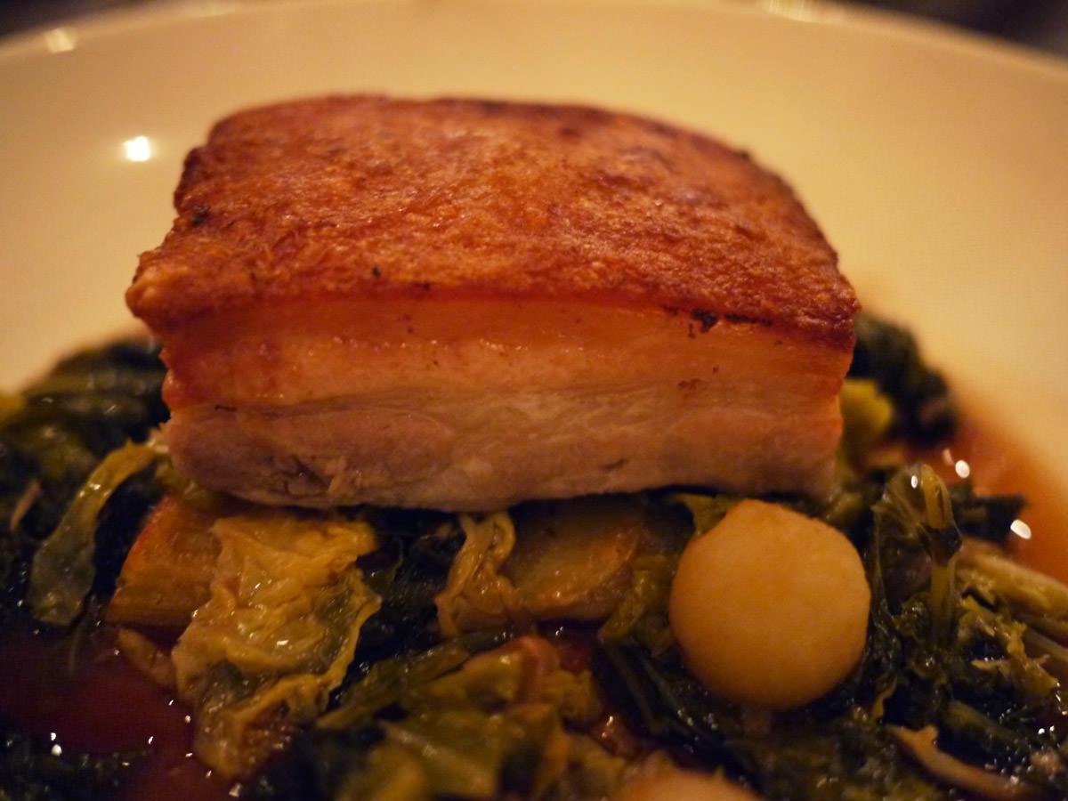 Wood roasted free range pork belly close-up