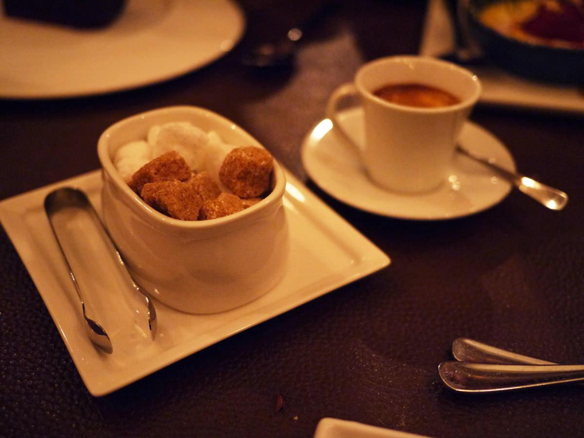 Espresso coffee with sugar cubes