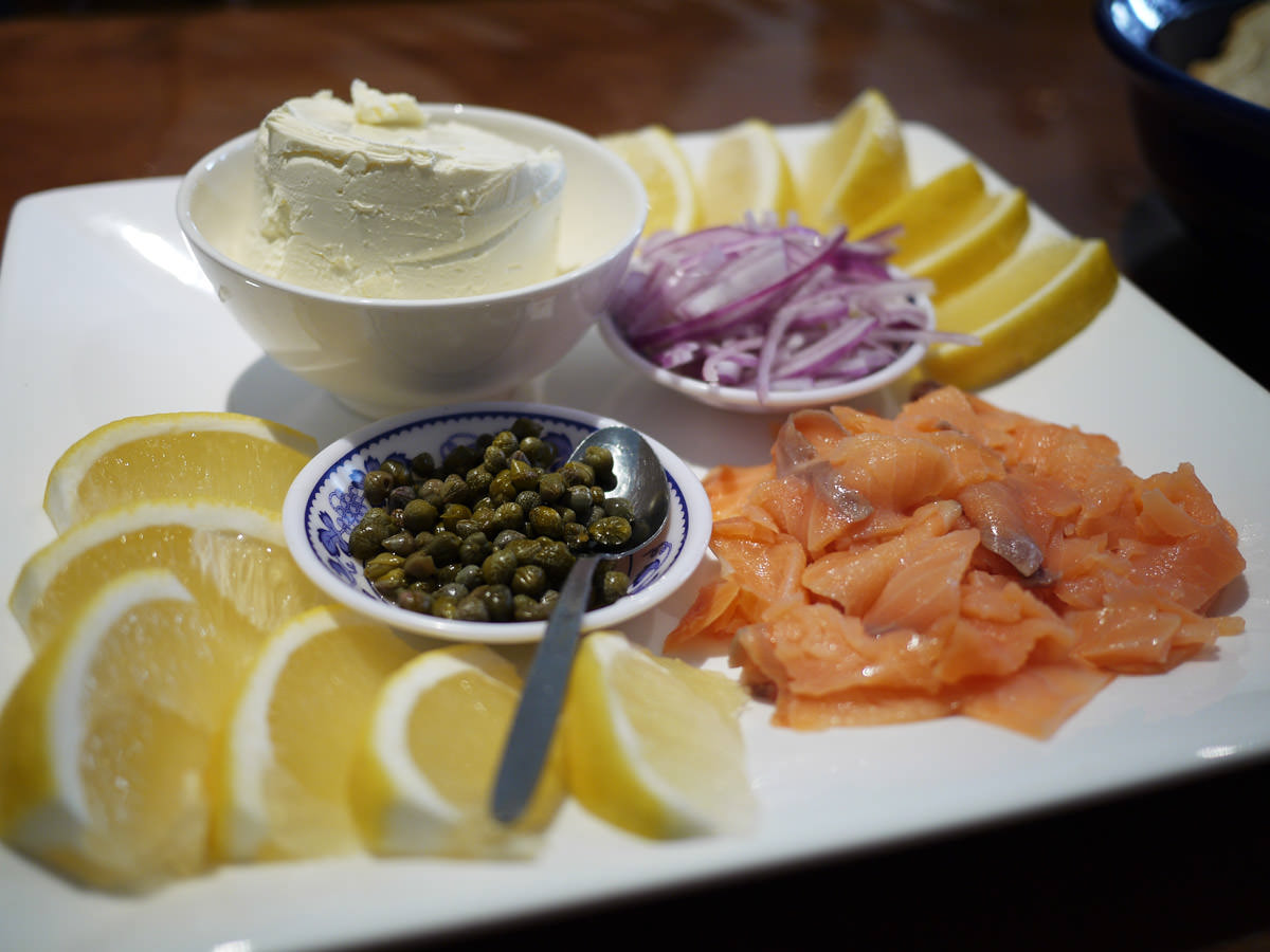 Platter of smoked salmon, cream cheese, red onion, capers and lemon
