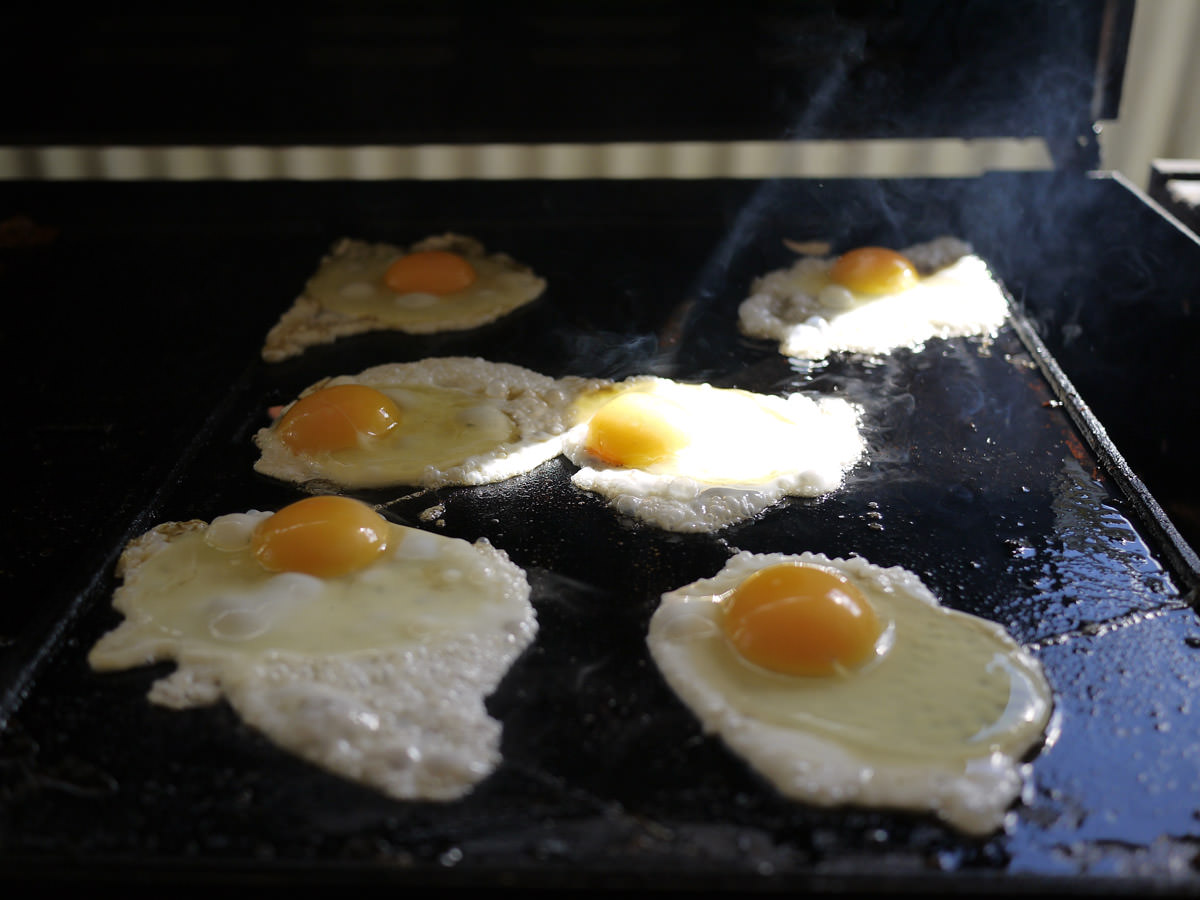 Eggs frying on the barbecue