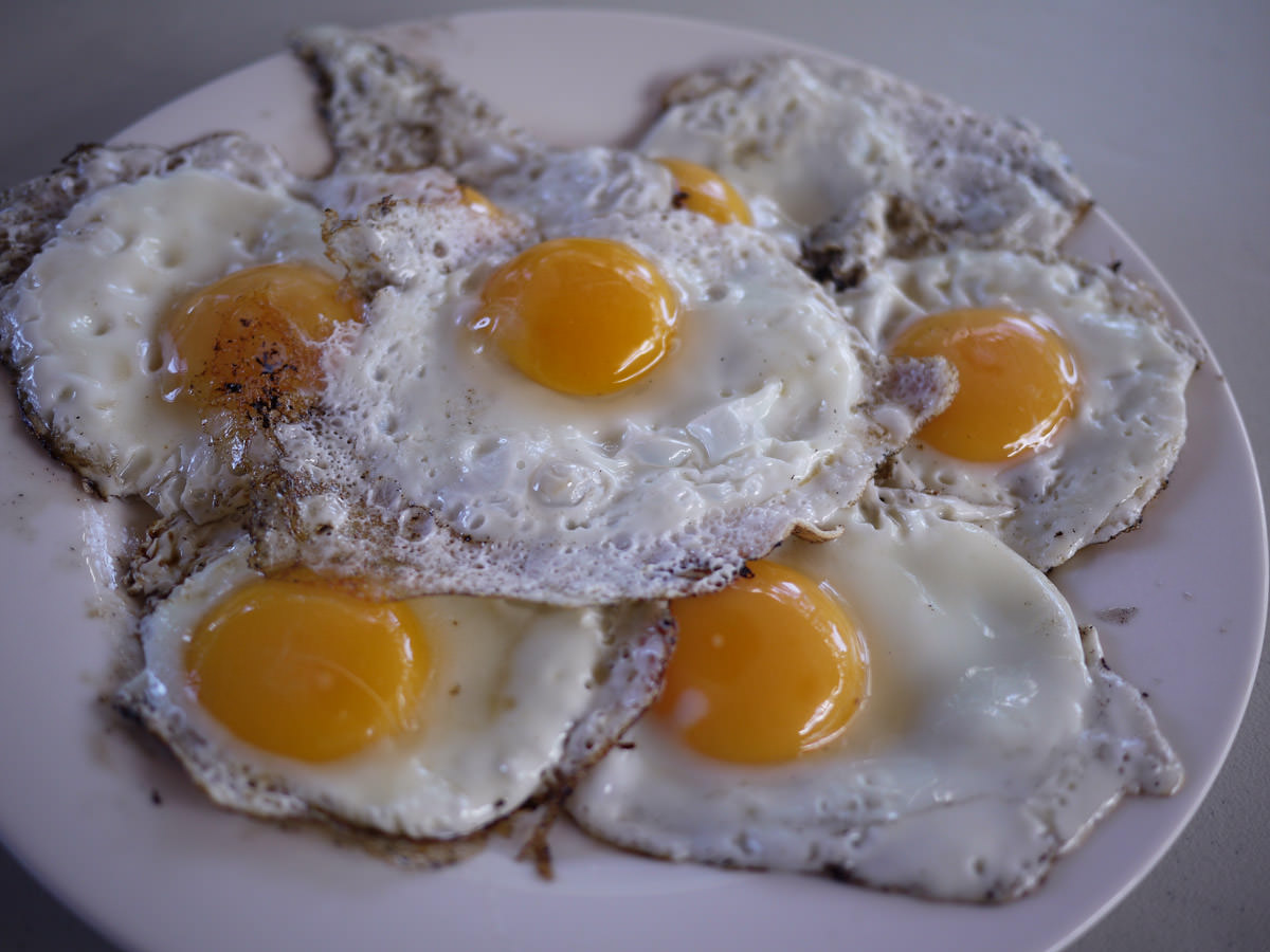 Fried eggs cooked on the barbecue