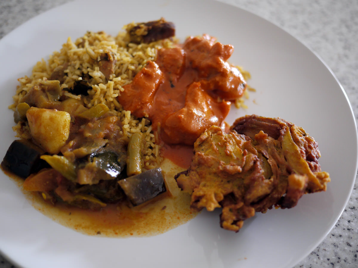 Butter chicken, vegetable curry, biryani and onion bhaji from Maya Masala