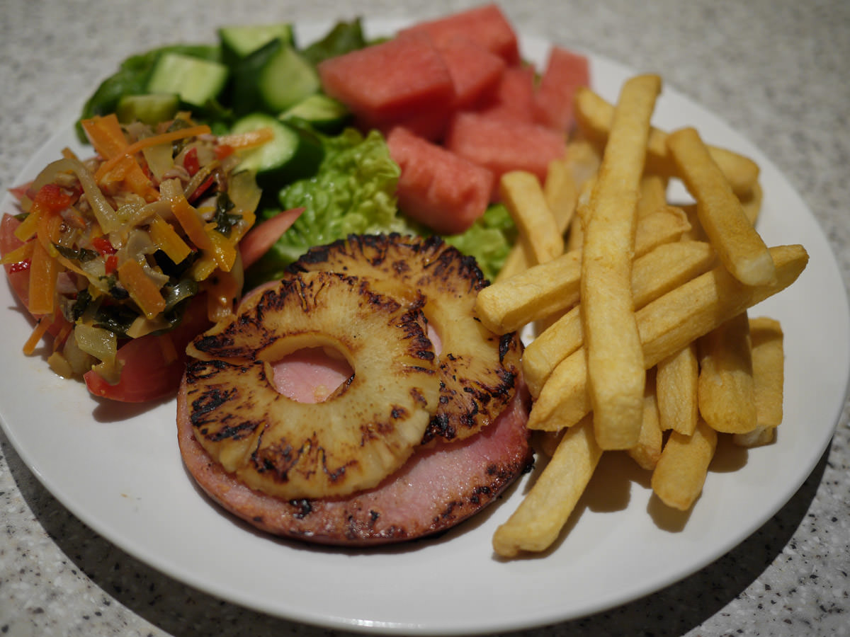 Ham steak and pineapple, oven fries, vegetables, cucumber and watermelon