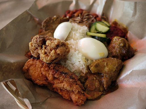 Nasi lemak with chicken rendang, fried chicken, chicken curry