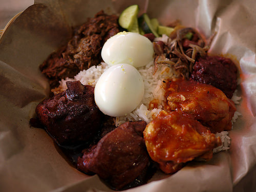 Nasi lemak with beef rendang, tomato chicken, kicap manis chicken