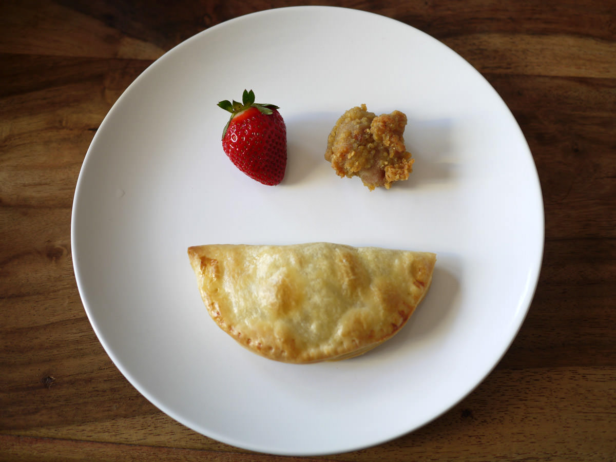 My food in the form of a smiley face - strawberry, chicken nugget, mushroom puff