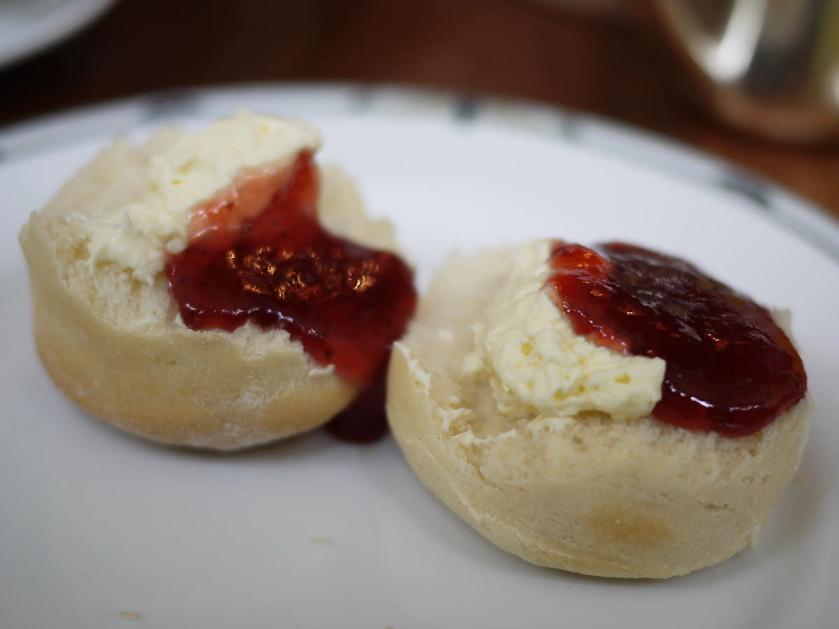 Scone with strawberry jam and cream