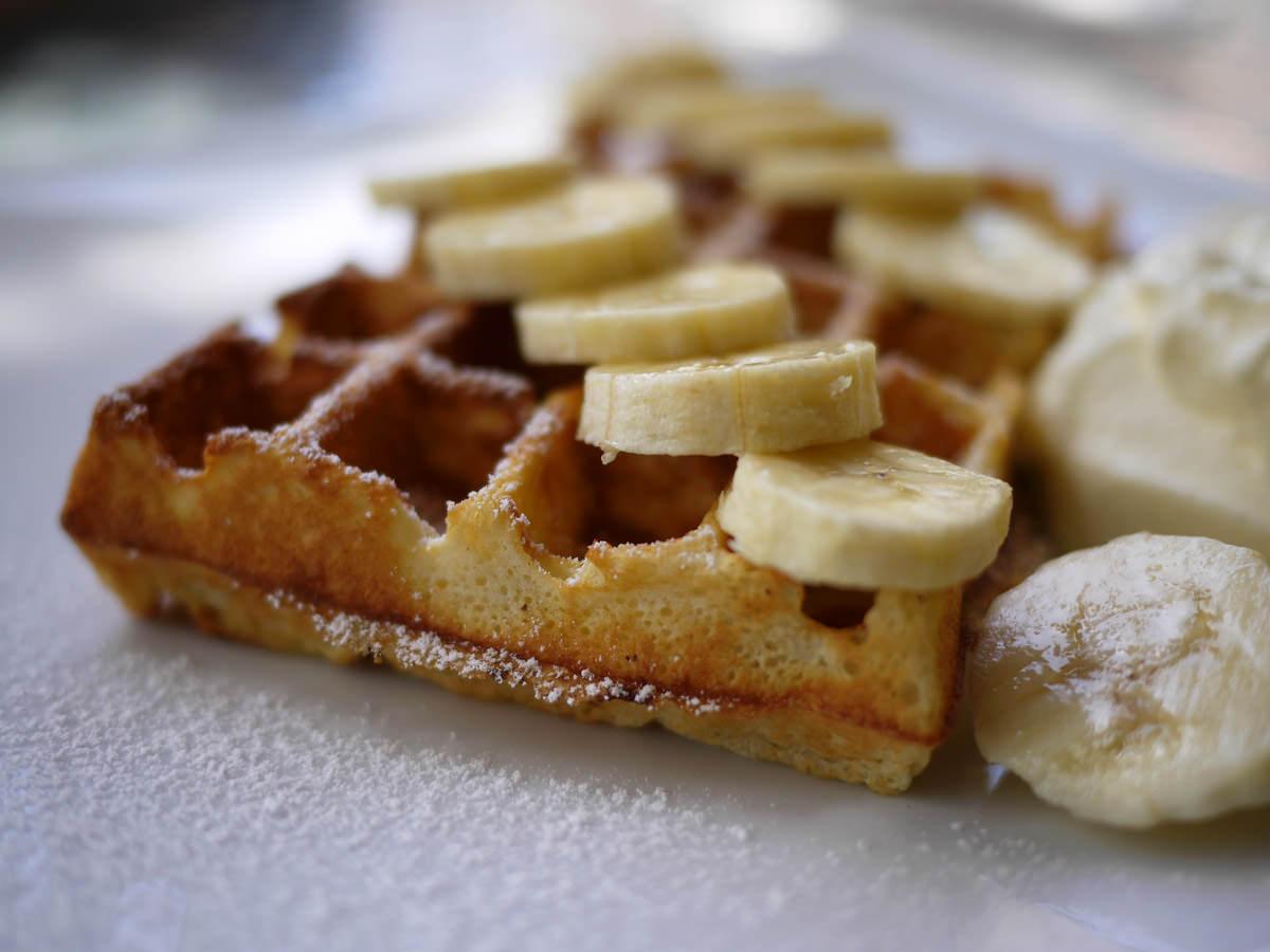 Waffle with banana and cream - close-up