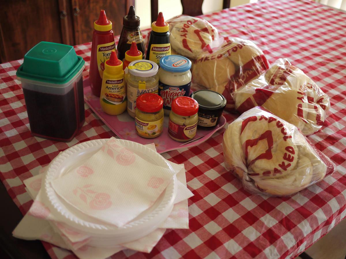 Plates, napkins, sauces, buns, beetroot