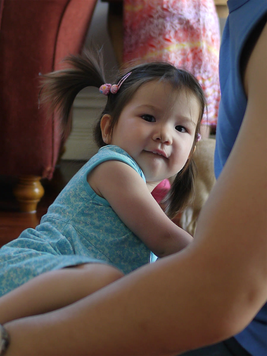 A happy face on Boxing Day: Zoe, climbing onto her dad's knee to play Horsey