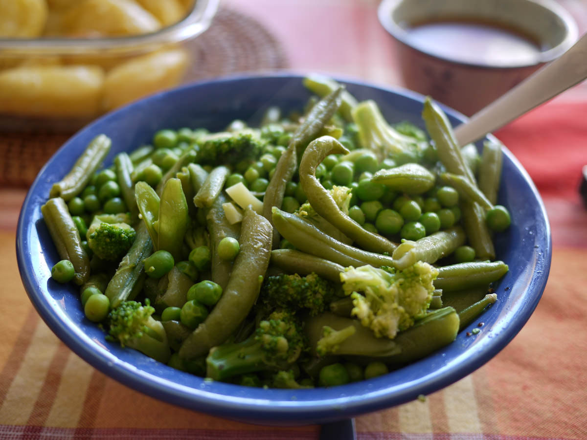 Steamed green vegetables - peas, beans and broccoli
