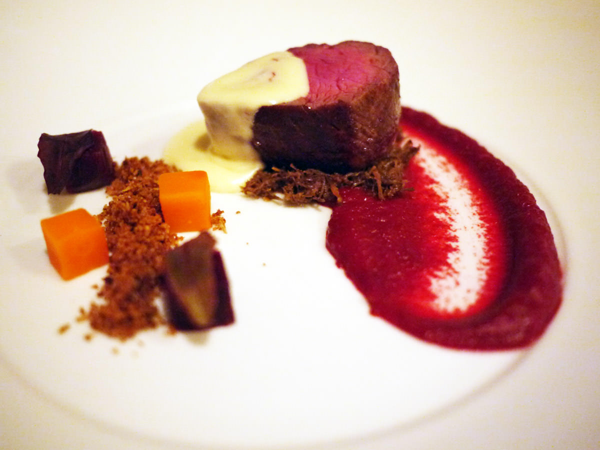 Third course: Beef eye fillet on braised beef cheek with beetroot puree, carrot and beetroot cubes, cauliflower crumble and blue cheese sauce