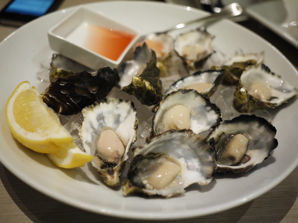 A dozen oysters natural with red wine vinaigrette