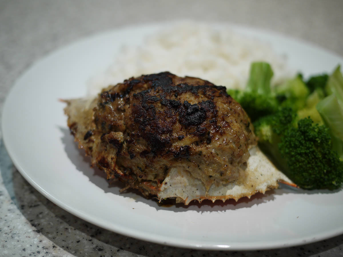Pork and crab stuffed in crab shell with broccoli and rice