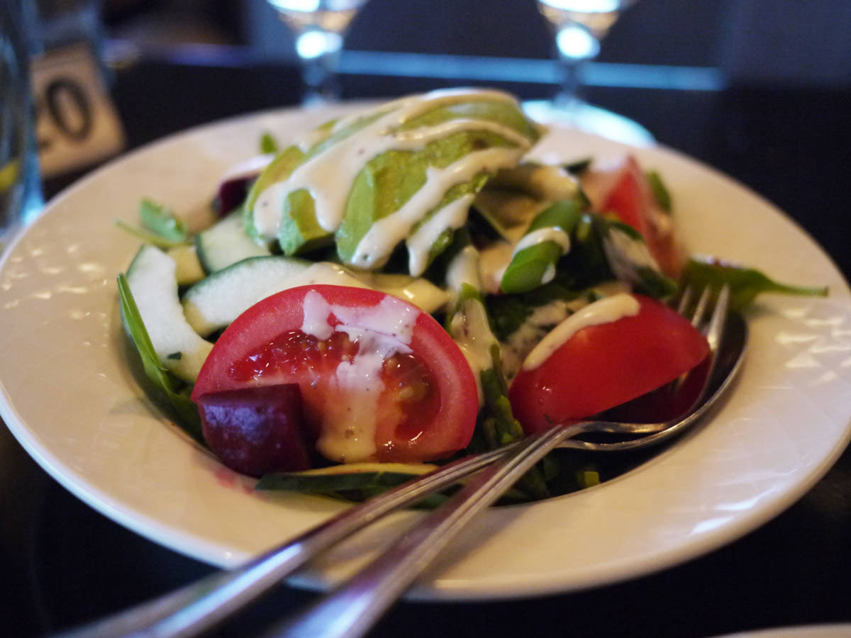 Garden salad, avocado, asparagus, vine ripened tomatoes, seeded mustard & orange dressing (AU$13.50)