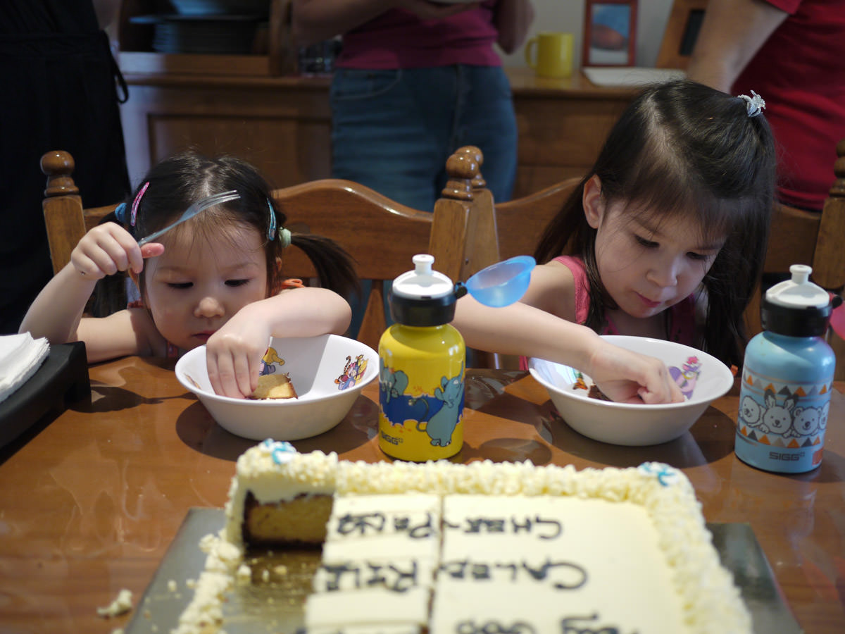 The girls eat cake