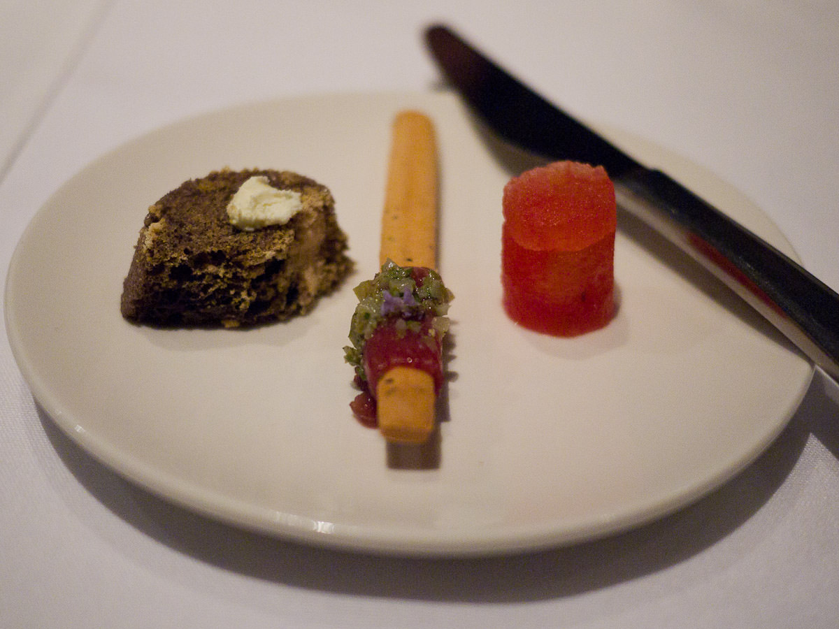 Olive sponge with cream cheese, grissini with lamb tartare and cornichon, watermelon pastille