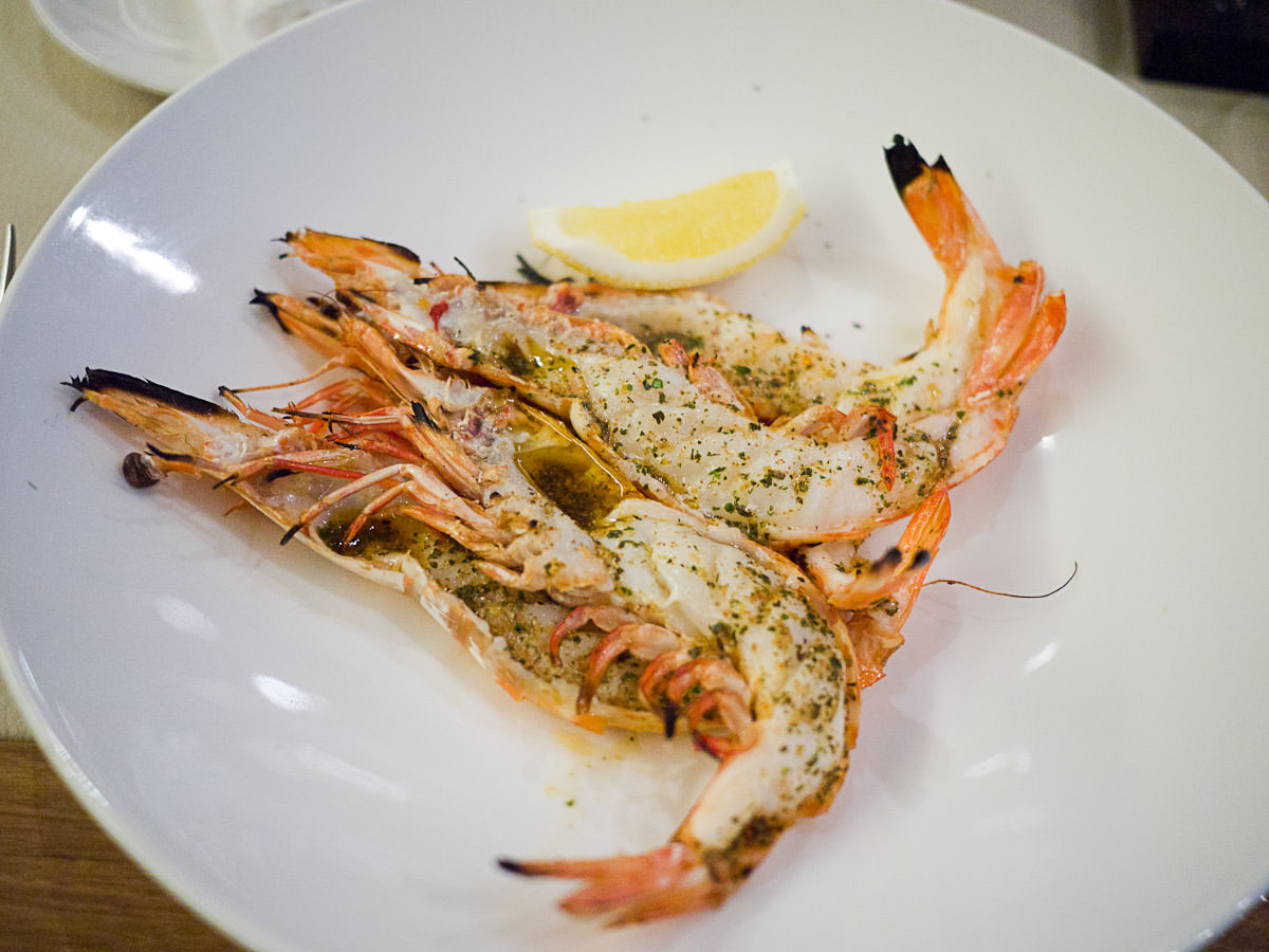 Charcoal roast king prawns, split and marinated (AU$30)