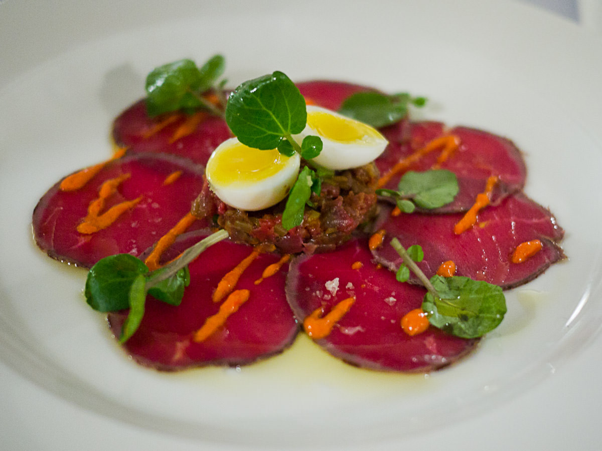 Carpaccio of beef, beef tartare, quail egg, mojo picante (spicy red pepper sauce), watercress (AU$18)