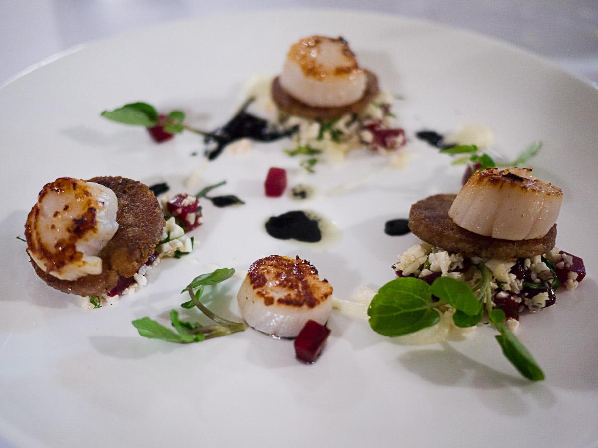 Seared scallops, confit pork, cauliflower, mint & squid ink (AU$19)