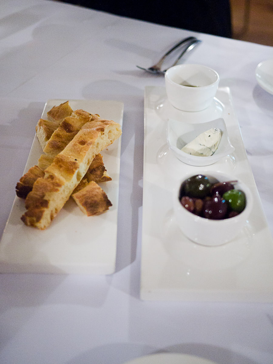 Wood fired Turkish bread, EVOO with merlot vinegar, marinated olives and dip (AU$12)