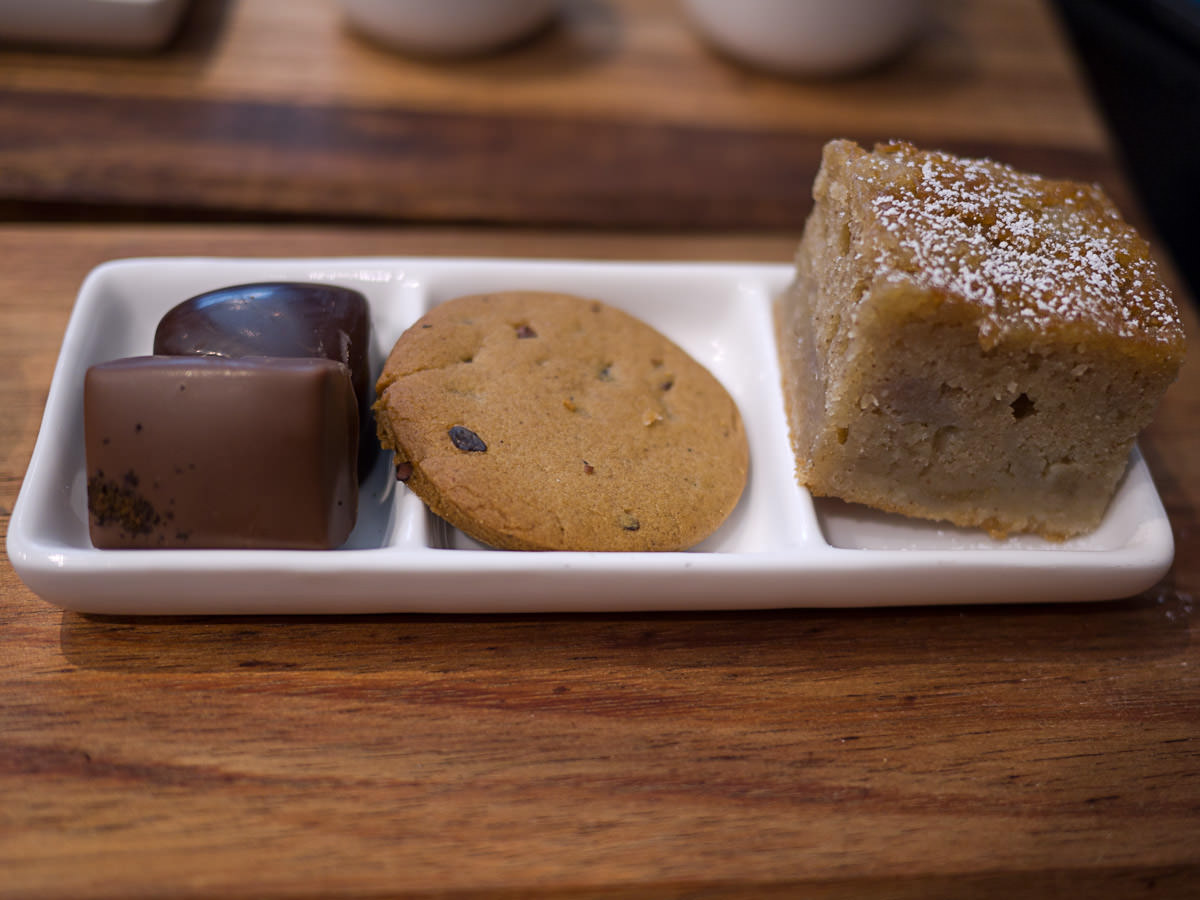 Chocolates, ginger cookie, pear and cinnamon cake