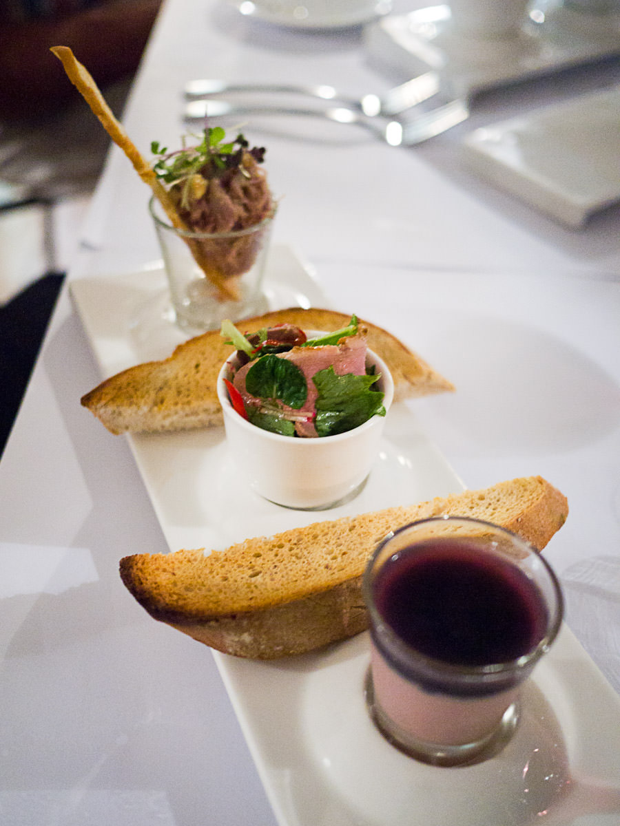 Duck rilletes & hazelnuts, duck liver parfait, plum, smoked duck breast salad and toast (AU$18)