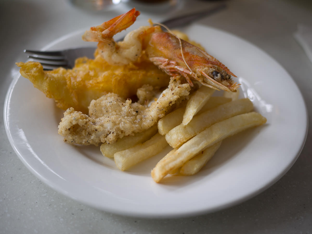 Seafood on a plate - squid, fish, prawn and chips