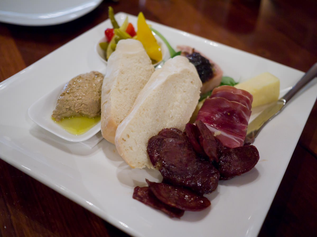 Tasting plate: pork and pistachio terrine, venison chorizo, duck liver pate, cheddar, baguette, home made pickles