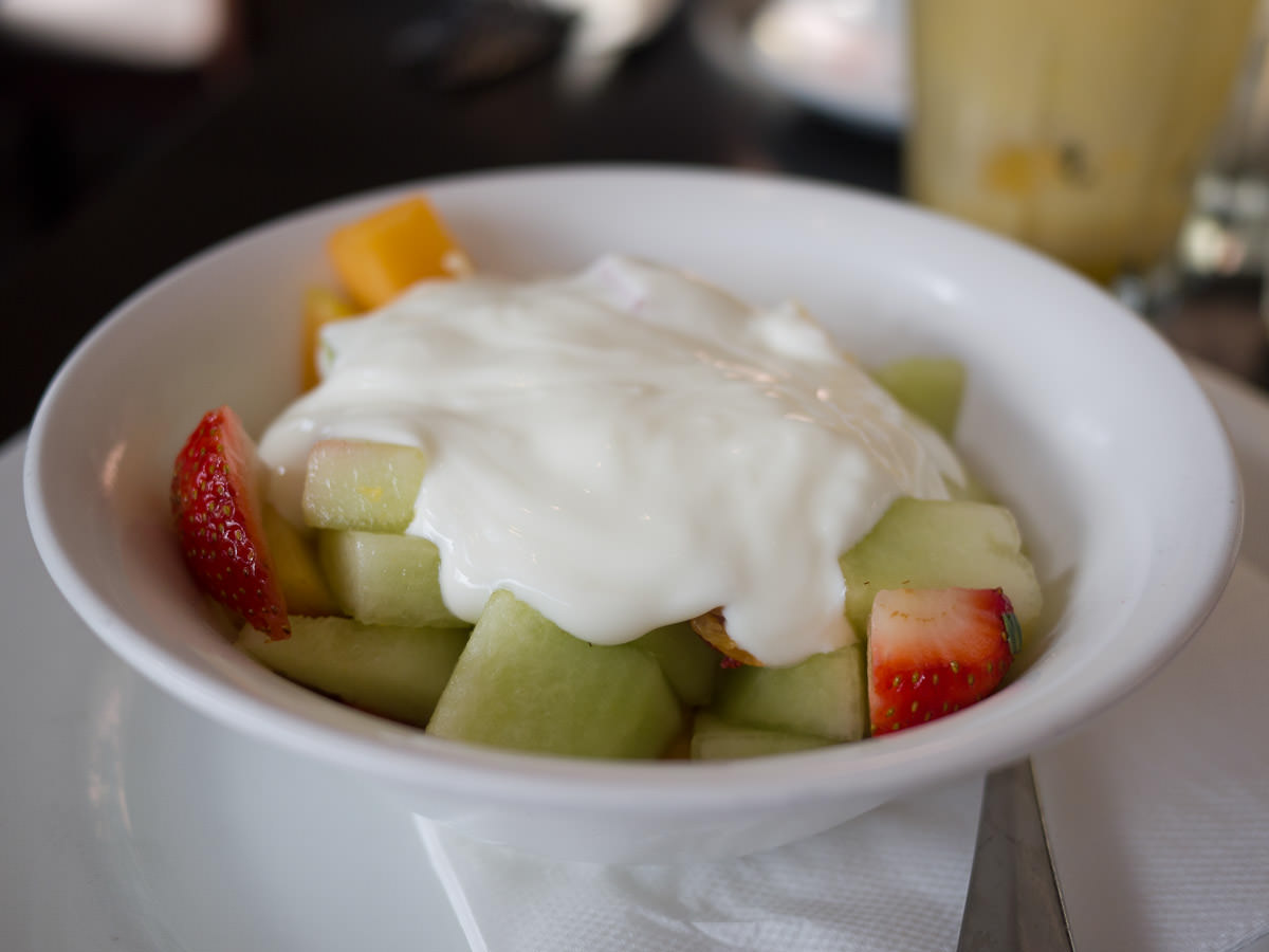 Fruit salad topped with natural yoghurt (AU$8.80)