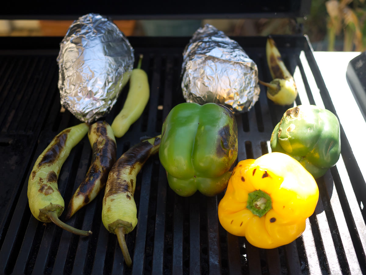 Barbecuing peppers and eggplant (in foil)