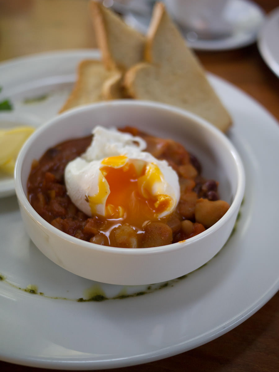 Perfectly gooey poached egg on baked beans