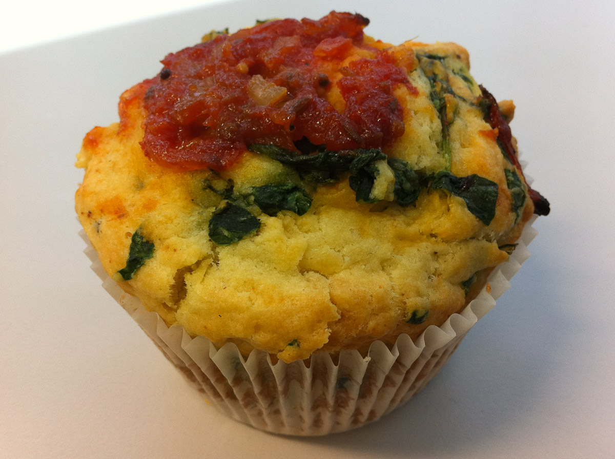 Spinach and feta savoury muffin topped with chef's special tomato relish
