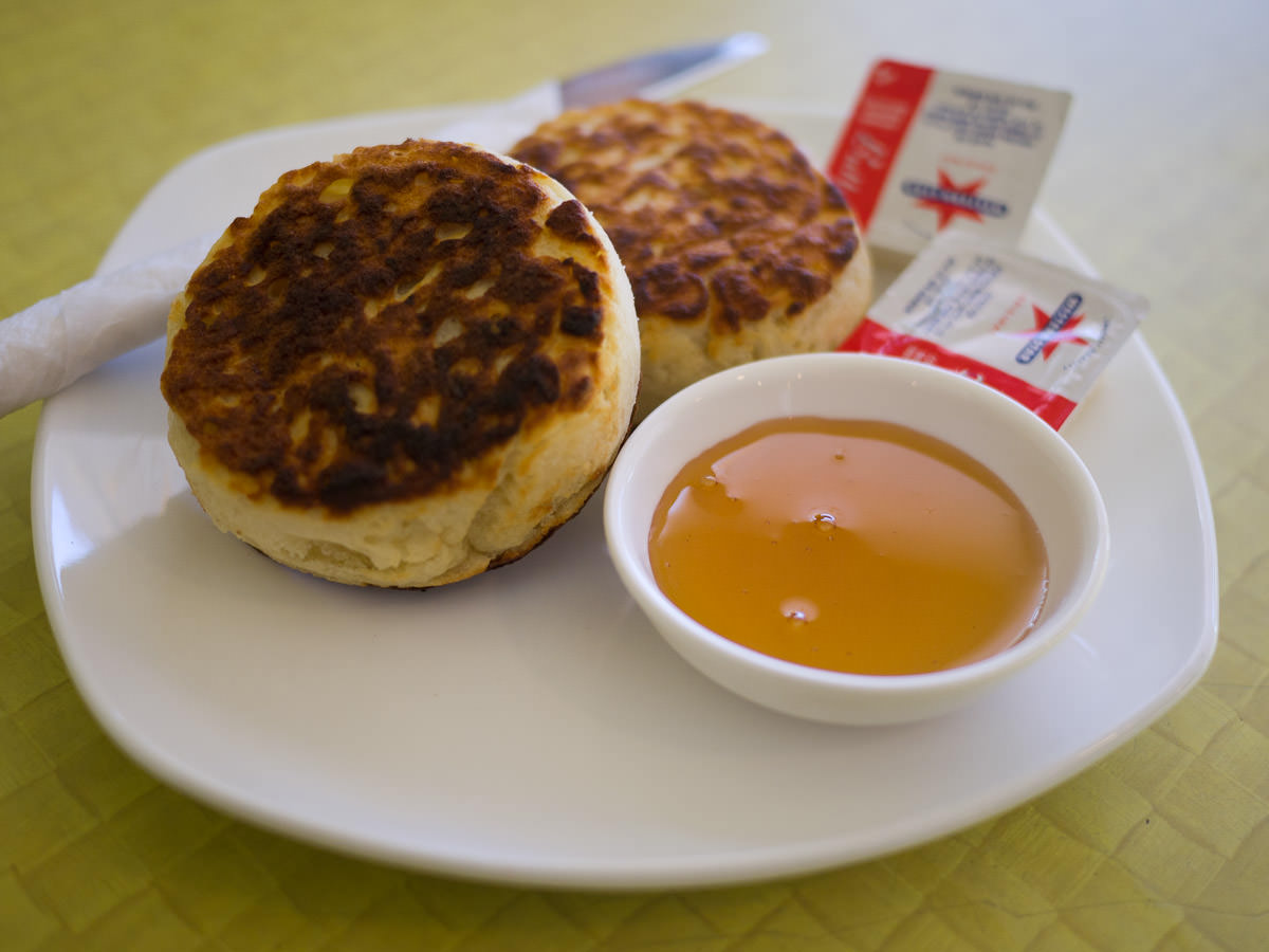 Crumpets with butter and honey