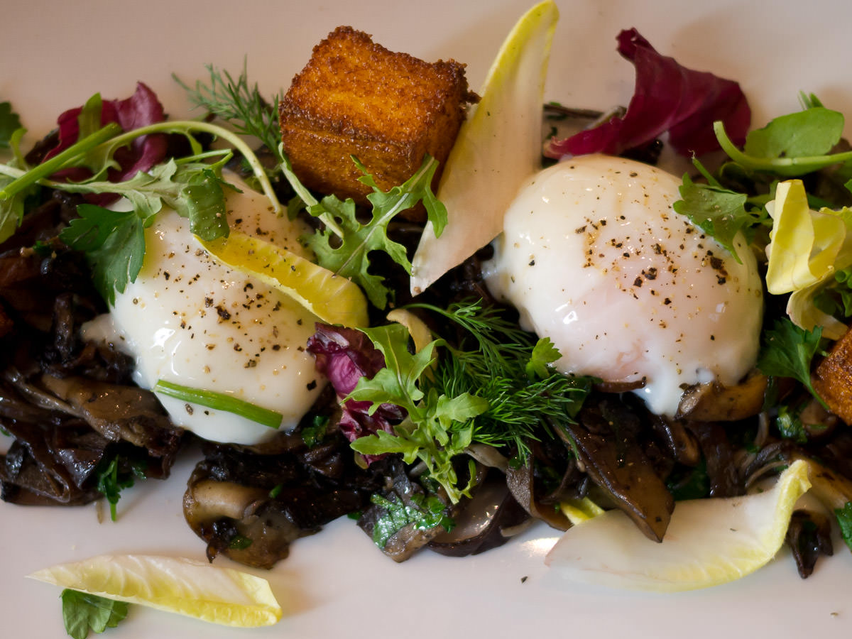 Wild mushrooms, slow cooked eggs and grilled polenta - close-up