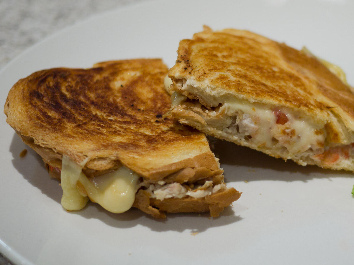 Toasted sandwich with barbecue chicken, mayo, swiss cheese, tomato, chardonnay wholegrain mustard