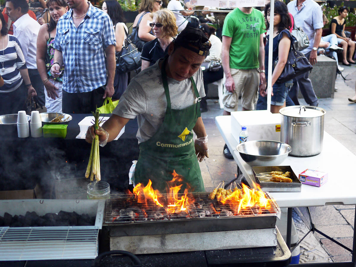Satay man basting chicken satay, Twilight Hawker Market, Perth